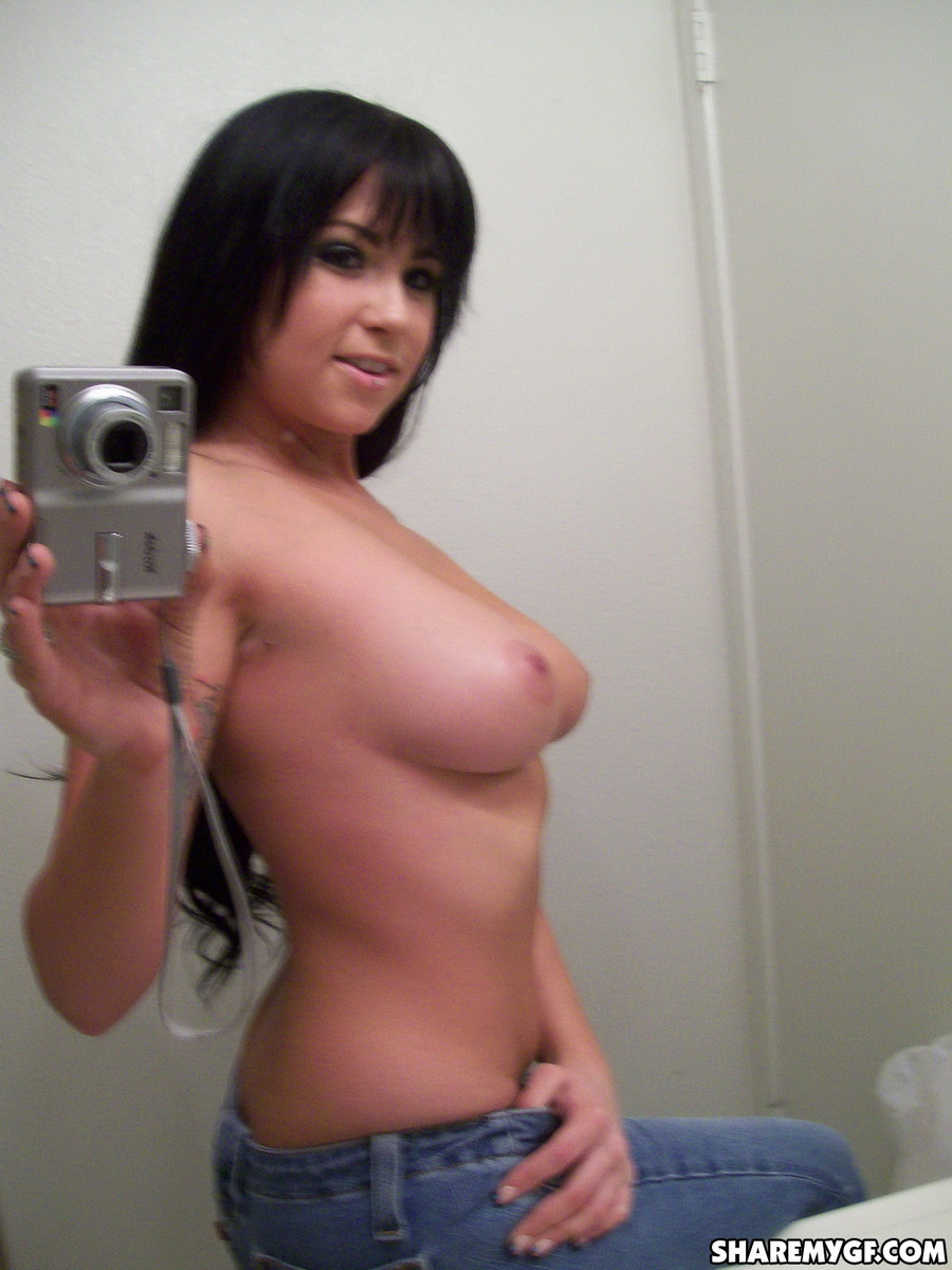Share My GF: Busty girlfriend takes mirror pictures as she strips naked exposing her big juicy tits and tight little pussy