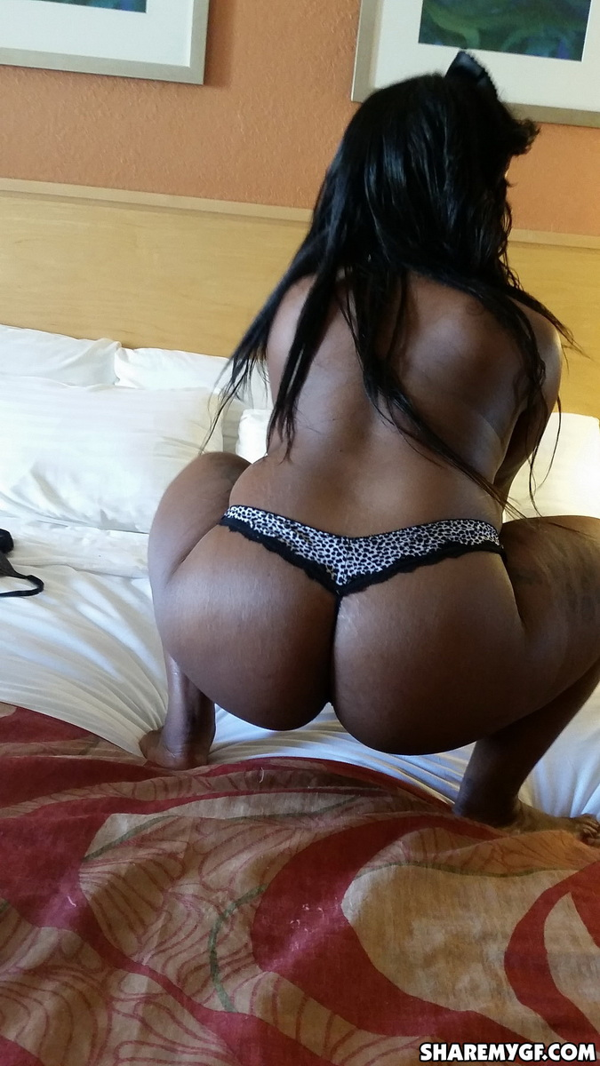 Black girlfriend shows off her big booty in a tiny thong as she gets naked