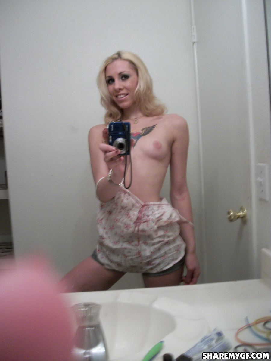 Share My GF: Tattooed skinny blonde girlfriend takes selfshot pictures in the mirror of her perky tits